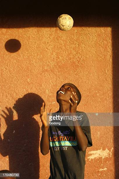 Guinean child playing with a ball Douggar Senegal