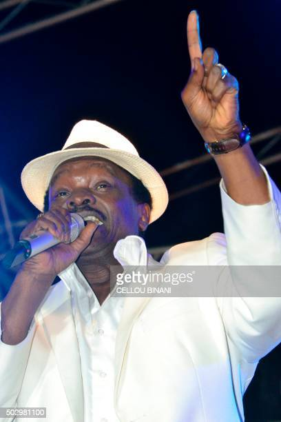 Guinean muscian Mory Kante performs during the Bye bye Au revoir Ebola concert on December 30 2015 in Conakry International artists Youssou Ndour...