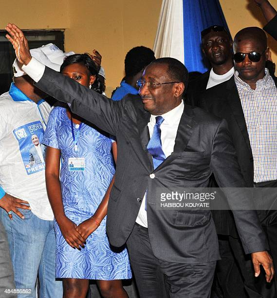 Guinean opposition politician Sidya Toure of the Union of Republican Forces party waves after his nomination as candidate for the presidential...
