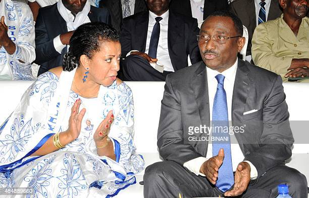 Guinean opposition politician Sidya Toure of the Union of Republican Forces party sits next to his wife after his nomination as his party's candidate...
