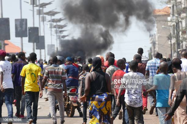 Guinean opposition supporters burn tyres in a street during a demonstration against a series of bloody crackdowns on opposition demonstrations on...
