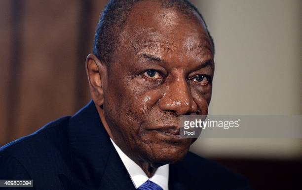 Guinean President Alpha Condé looks on in the Cabinet Room of the White House April 15 2015 in Washington DC The three Presidents discuss the...