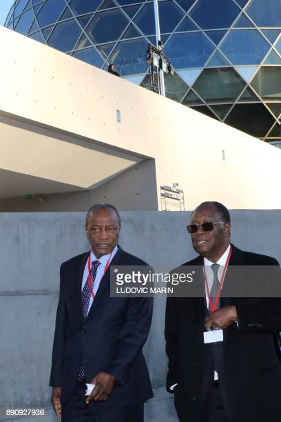 Guinean President Alpha Conde and arrive to the One Planet Summit on December 12 at La Seine Musicale venue on the ile Seguin in BoulogneBillancourt...