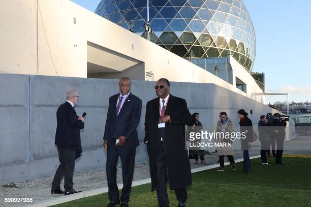 Guinean President Alpha Conde and Ivorian President Alassane Ouattara arrive to the One Planet Summit on December 12 at La Seine Musicale venue on...