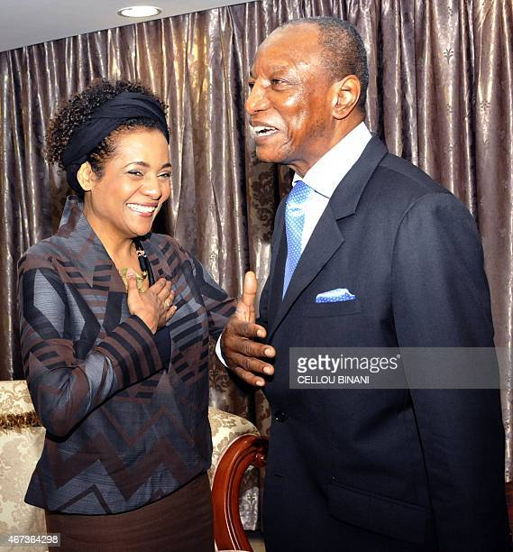 Guinean President Alpha Conde meets with SecretaryGeneral of the International Francophone Organization Michaelle Jean on March 23 2015 at the...