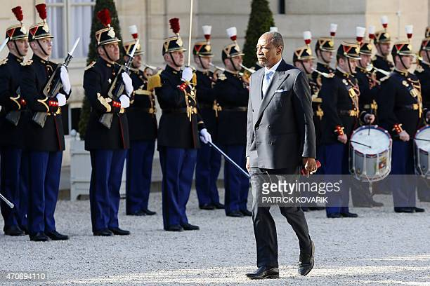 Guinean President Alpha Conde reviews troops of the French Republican Guard upon his arrival for a meeting with the French president at the Elysee...