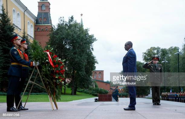 Guinean President Alpha Conde takes part in a wreathlaying ceremony at the Tomb of the Unknown Soldier by the Kremlin wall in Moscow on September 28...