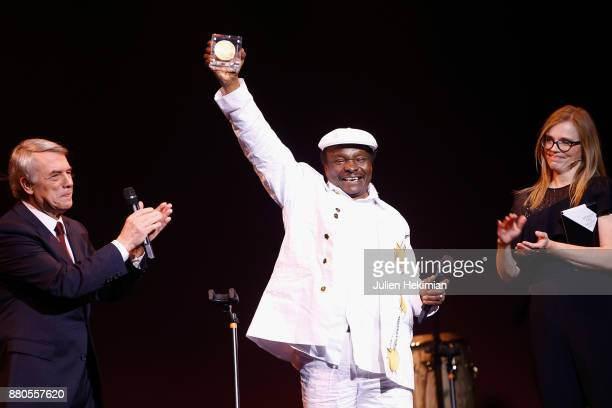 Guinean Singer Mory Kante is being awarded with the Great Prize of World Music by Salvatore Adamo and Isabelle Carre during les Grands Prix De La...
