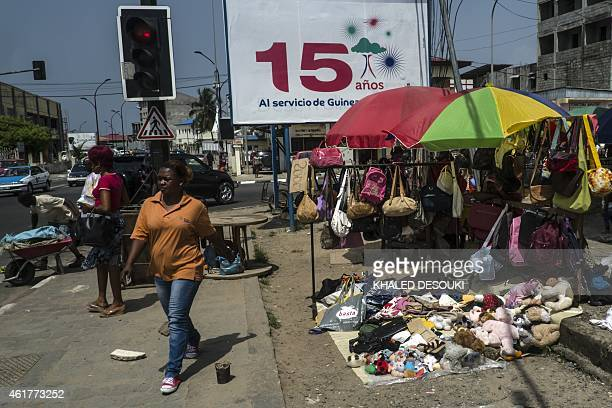 A Guinean woman walks past a market in Bata on January 19 2015 as Equatorial Guinea hosts the 2015 African Cup of Nations football tournament AFP...