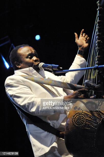 Guineanborn musician Mory Kante plays the Kora while oerforming with the 'Yeke Yeke Anniversary Tour' band on the the 'world stage' on the Hajogyar...