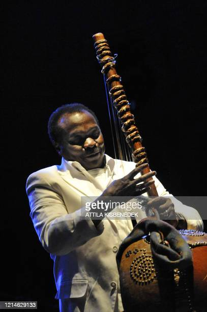 Guineanborn musician Mory Kante plays the Kora while with the 'Yeke Yeke Anniversary Tour' band on the the 'world stage' on the Hajogyar Island of...