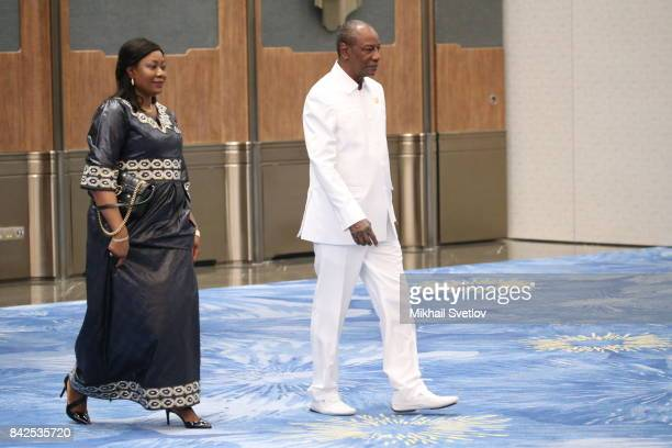 Guinea's First Lady Djebe Kaba Conde and Guinea's President Alpha Conde arrive to the welcoming ceremony prior to the dinner on September 4 2017 in...