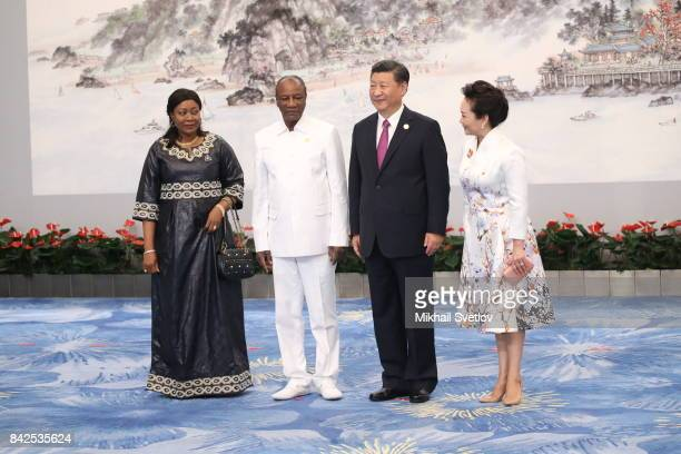 LR Guinea's First Lady Djebe Kaba Conde Guinea's President Alpha Conde Chinese President Xi Jinping his wife Peng Liyuanpose for a photo prior to the...