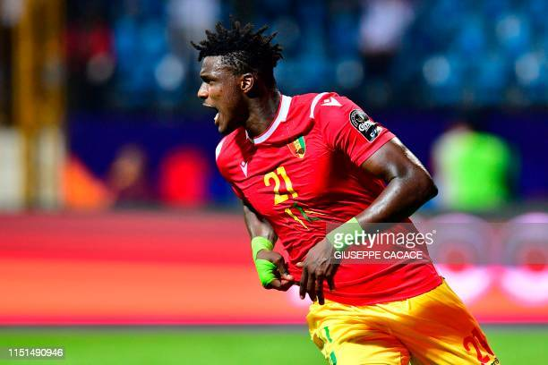 Guinea's forward Sory Kaba celebrates his goal during the 2019 Africa Cup of Nations football match between Guinea and Madagascar at Alexandria...