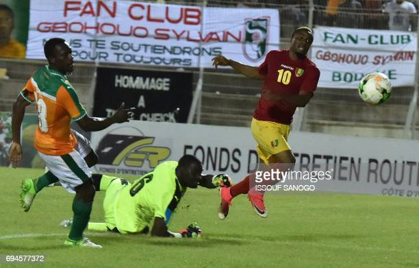 Guinea's François Kamano scores a goal past Ivory Coast's goalkeeper Sylvain Gbohouo during the 2019 African Cup of Nations football match qualifier...