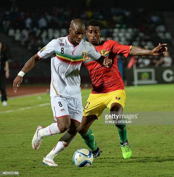 Guinea's midfielder Kevin Constant vies with Mali's midfielder Yacouba Sylla during the 2015 African Cup of Nations group D football match between...