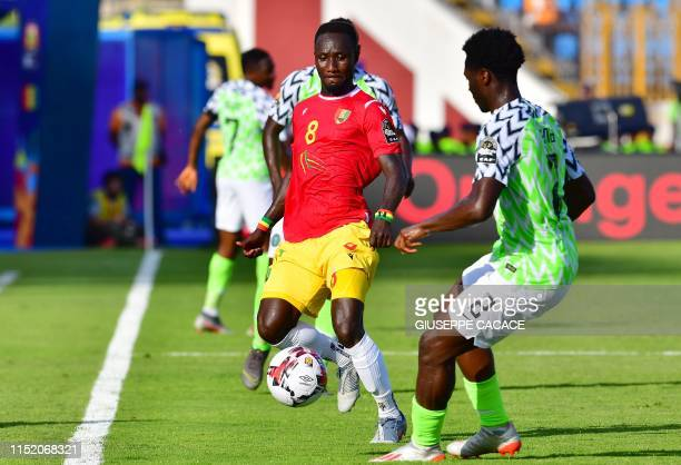 Guinea's midfielder Naby Keita is marked by Nigeria's defender Olaoluwa Aina during the 2019 Africa Cup of Nations football match between Nigeria and...