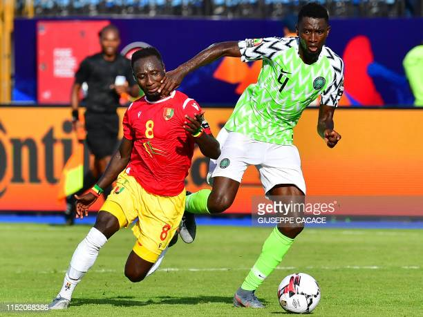 TOPSHOT Guinea's midfielder Naby Keita is marked by Nigeria's midfielder Wilfred Ndidi during the 2019 Africa Cup of Nations football match between...