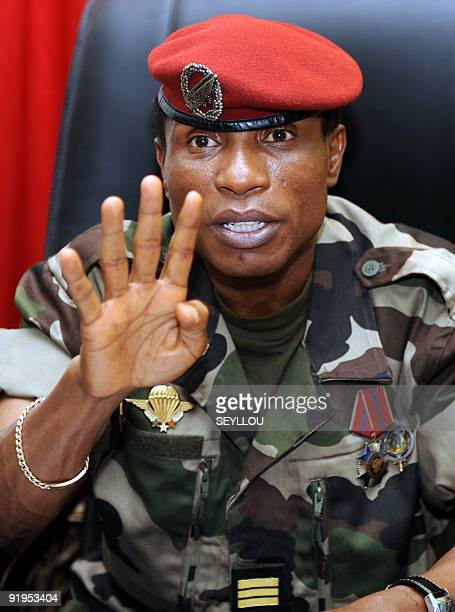 Guinea's military ruler Captain Moussa Dadis Camara speaks at his office at the Alpha Yaya Diallo camp in Conakry on October 1 2009 Guinea's ruling...