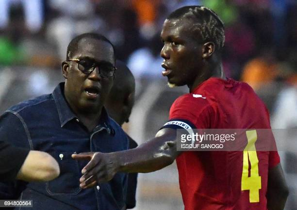 Guinea's national football team coach Mohamed Kanfory Lape Bangoura speaks with team captain Florentin Pogba on June 10 2017 during the 2019 African...