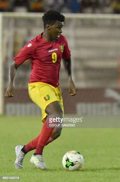 Guinea's national football team midfielder Abdoulaye Sadio Diallo controls the ball on June 10 2017 during the 2019 African Cup of Nations qualifier...