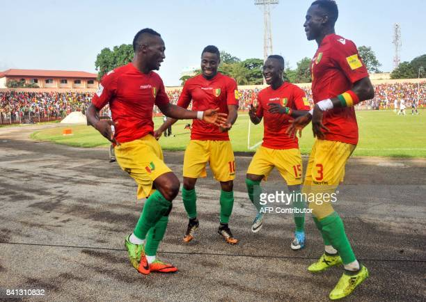 Guinea's National football team players Issiaga Sylla Naby Keita and Francois Kamano celebrates a goal during the 2018 FIFA World Cup qualifying...