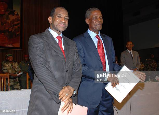 Guinea's new interim Prime Minister Jean-Marie Dore and General Sekouba Konate, president of the transition government pose on January 26, 2010 in...