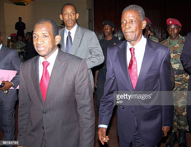 Guinea's new interim Prime Minister Jean-Marie Dore and General Sekouba Konate, president of the transition government walk on January 26, 2010 in...