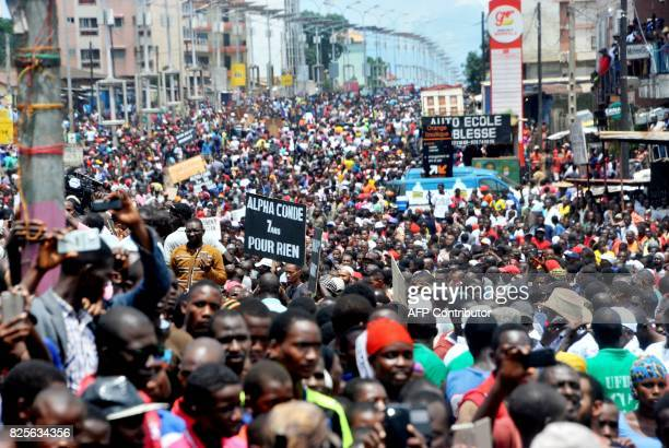 Guinea's opposition supporters walk during a demonstration in Conakry on August 2 2017 Thousands of opposition activists took to the streets of...