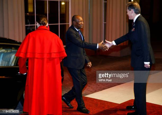 Guinea's President Alpha Conde arrives as Prince William, Duke of Cambridge and Catherine, Duchess of Cambridge host a reception to mark the...