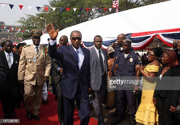 Guinea's President Alpha Conde arrives for the inagural address of Liberian President Ellen Johnson Sirleaf on January 16 2012 in Monrovia after...