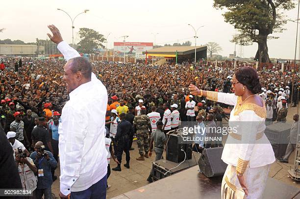 Guinea's president Alpha Konde and Guinea's First Lady Djene Kaba Conde waves to the public at the Bye bye Au revoir Ebola concert on December 30...