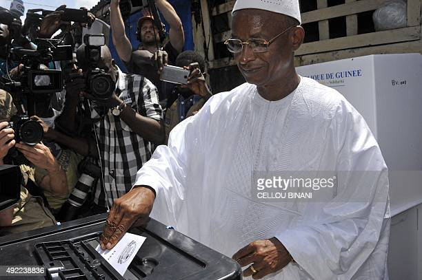 Guinea's presidential candidate and opposition leader Cellou Dalein Diallo casts his ballot at a polling station during the first round of the...