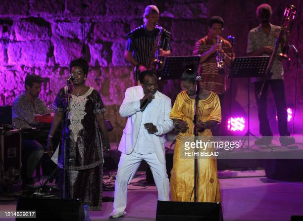Guinea's singer Mory Kante performs during the 46th session of the International Carthage festival at the Roman theatre in Carthage near Tunis on...