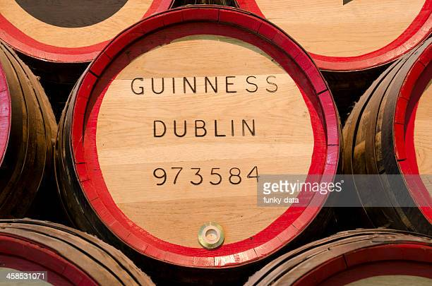 guiness beer barrel in close up - guinness stock photos and pictures