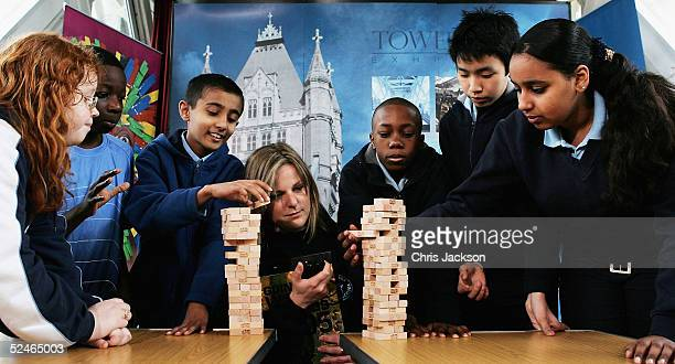 Guiness World Records adjudicator Susan Morrison looks on as pupils from Tower Bridge school compete against current record holders Alex Agboola John...