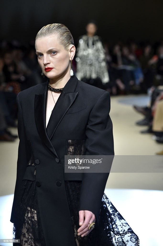 Guinevere Van Seenus walks the runway during the Alexander McQueen show as part of the Paris Fashion Week Womenswear Fall/Winter 2018/2019 on March 5, 2018 in Paris, France.