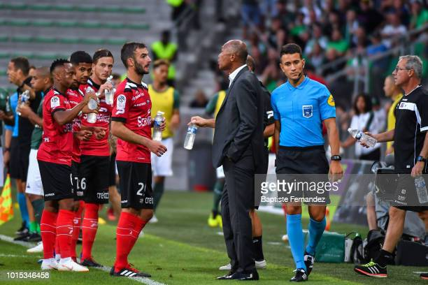 Guingamp head coach Antoine Komnouare talks with Christophe Kerbrat of Guingamp during the French Ligue 1 match between AS Saint Etienne and EA...