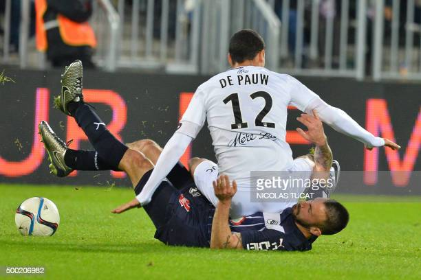 Guingamp's Belgian forward Nill de Pauw falls over Bordeaux German defender Diego Contento during the French Ligue1 football match between Bordeaux...