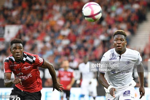 Guingamp's Cameroon defender Felix Eboa Eboa and Toulouse's forward Aaron Leya Iseka eye the ball during the French L1 football match between...