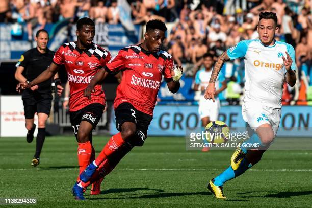 Guingamp's Cameroonian defender Felix Eboa Eboa fights for the ball with Marseille's Argentine midfielder Lucas Ocampos during the French L1 football...