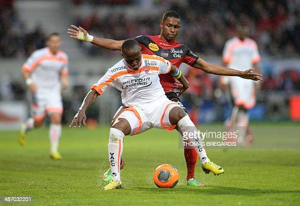 Guingamp's forward Christophe Mandanne vies with Valenciennes's midfielder Eloge Enza Yamissi during the French L1 football match Guingamp vs...