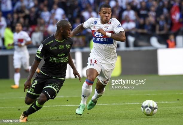 Guingamp's Franch-Congolese defender Jordan Ikoko vies with Lyon's Dutch forward Memphis Depay during the French L1 football match Lyon vs Guingamp ,...