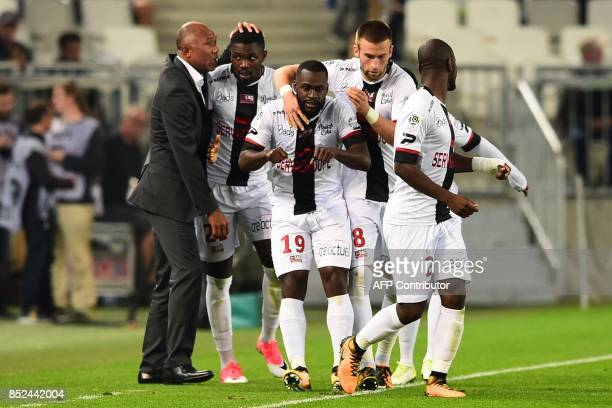 Guingamp's French coach Antoine Kombouaré Guingamp's French midfielder Yannis Salibur and teammates celebrate after scoring during the French Ligue 1...