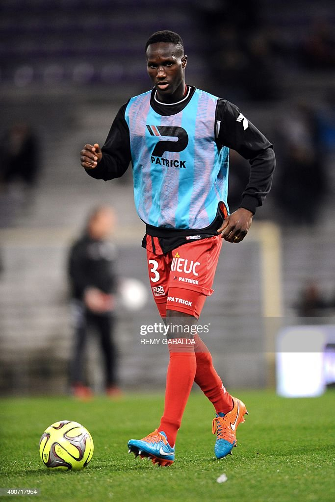 Guingamp's French defender Benjamin Angoua warms up prior to the French L1 football match Toulouse (TFC) vs Guingamp (EAG) on December 20, 2014 at the Municipal Stadium in Toulouse.