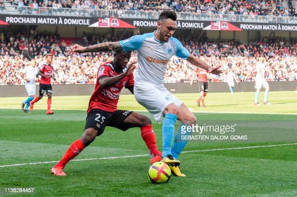 Guingamp's French defender Cheik Traore vies for the ball with Marseille's Argentine midfielder Lucas Ocampos during the French L1 football match...