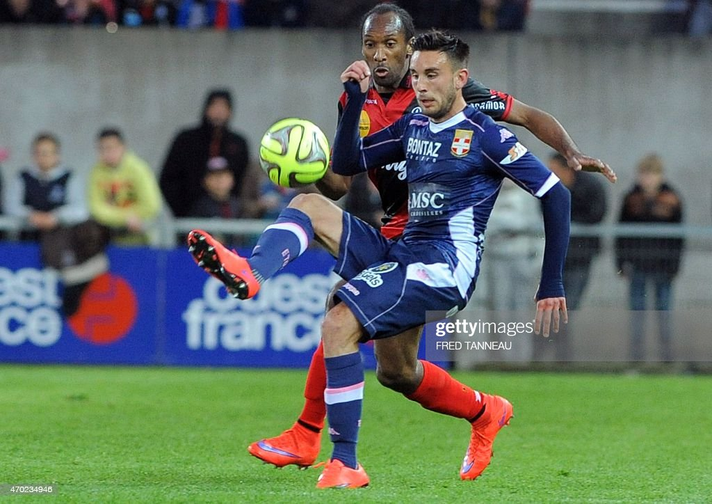 Guingamp's French defender Jeremy Sorbon (L) vies with Evian's French forward Adrien Thomasson during the French L1 football match between Guingamp and Evian on April 18, 2015 at the Roudourou stadium in Guingamp, western of France.