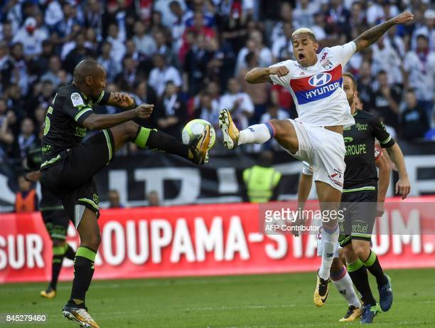 Guingamp's French defender Jeremy Sorbon vies with Lyon's Spanish forward Mariano Diaz during the French L1 football match Lyon vs Guingamp , on...