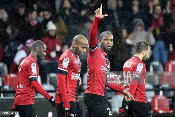 Guingamp's French defender Marcus Coco celebrates after scoring during the French L1 football match Guingamp vs Dijon on December 9, 2017 at the...