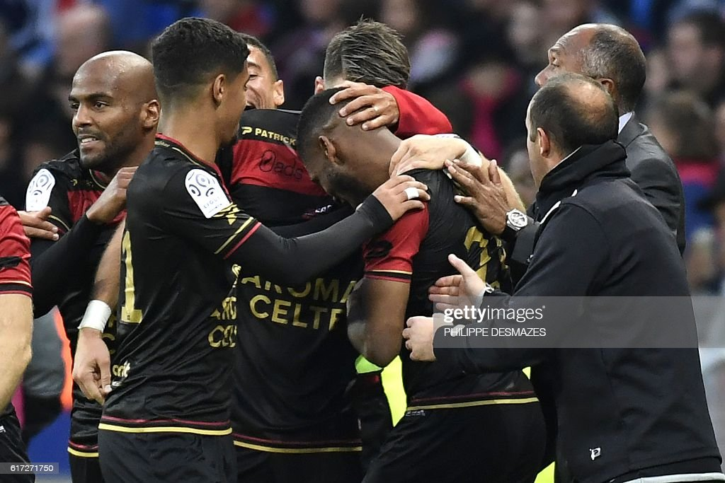 Guingamp's French defender Marcus Coco (C) celebrates with teammates after scoring a goal during the French L1 football match between Olympique Lyonnais and EA Guingamp on October 22, 2016, at the Parc Olympique Lyonnais in Decines-Charpieu near Lyon, southeastern France. / AFP / PHILIPPE